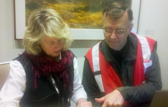 Danelle Stoppel, here with Dave Warren, a Red Cross disaster mental health volunteer from Rochester, NY, review the cases they've handled while working in Boston after the Boston Marathon bombings