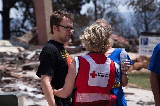 Danelle, pictured here in July 2012 while on deployment in Colorado, providing mental health services to a man who's home was destroyed by a wildfire.