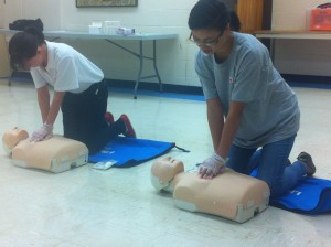Pictured: (Left) Megan Wood and (Right) Jingwen Li taking the CPR Certification Test
