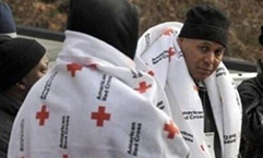 Passengers try to keep warm after their commuter train derailed in the Bronx. Credit: American Red Cross New York