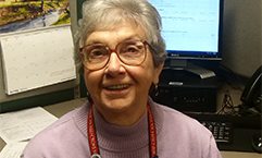 Alice Taylor, at a desk in Volunteer Administration