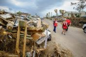 September 6, 2017. Port Aransas, Texas. Red Cross volunteers, from left, Nurse Minnie, Mental Heath worker Julie and Nurse Carol go street to street in Port Aransas, which was hit hard by Hurricane Harvey. Photo by Chuck Haupt for the American Red Cross.